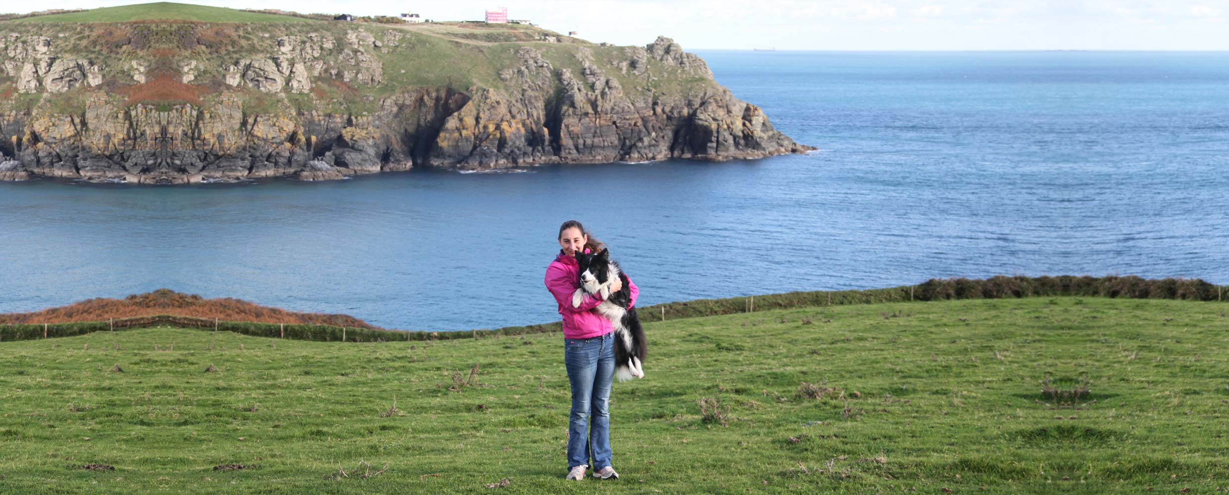 Alison Roets holding Freya the Border Collie, Landsend, Cornwall