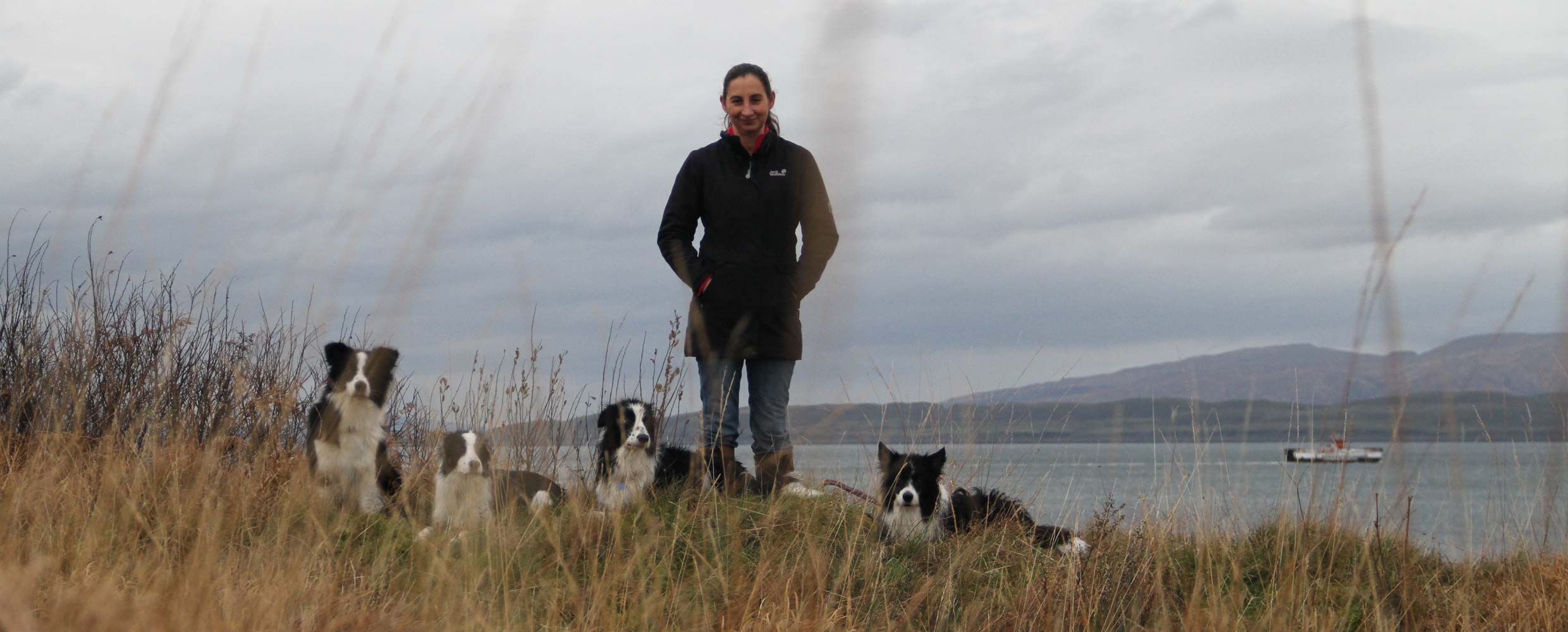 Alison Roets with her Border Collies overlooking Loch Lomond, Scotland